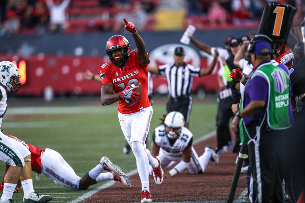 UNLV Rebels wide receiver Darren Woods Jr. (10) runs the ball against the Hawaii Warriors during the third quarter of a football game at Sam Boyd Stadium in Las Vegas, Saturday, Nov. 4, 2017. UNLV ...