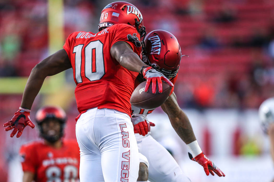 UNLV Rebels wide receiver Darren Woods Jr. (10), left, celebrates with a teammate after running the ball against the Hawaii Warriors during the third quarter of a football game at Sam Boyd Stadium ...