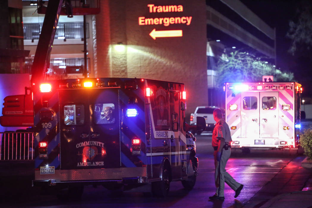An ambulance rushes to the trauma emergency room at the Sunrise Hospital and Medical Center Monday, Oct. 2, 2017, after a Sunday night shooting on the Strip left 58 dead. Joel Angel Juarez Las Veg ...