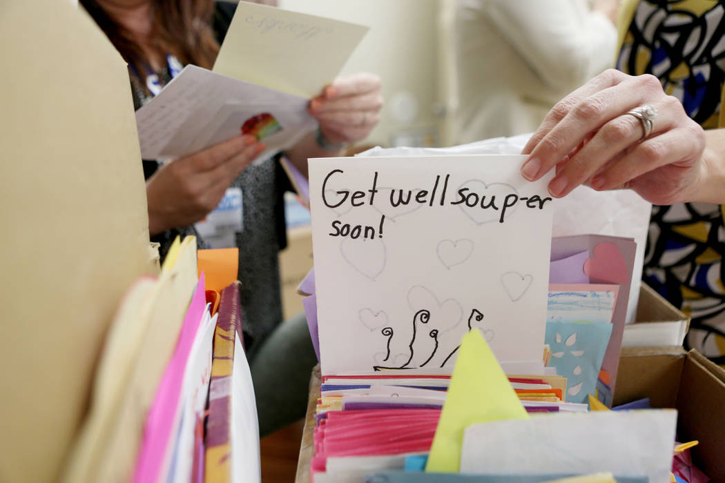 University Medical Center employees go through the countless cards given to patients and staff at UMC after the  Oct. 1, tragedy, Thursday, Oct 26, 2017 at UMC in Las Vegas. Elizabeth Brumley Las  ...