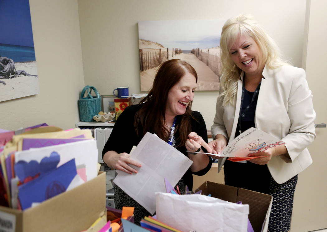 Director of patient experience Haley Hammond, left, and the director of medical staff Shana Tello go through the countless cards given to patients and staff at UMC after the  Oct. 1, tragedy, Thur ...