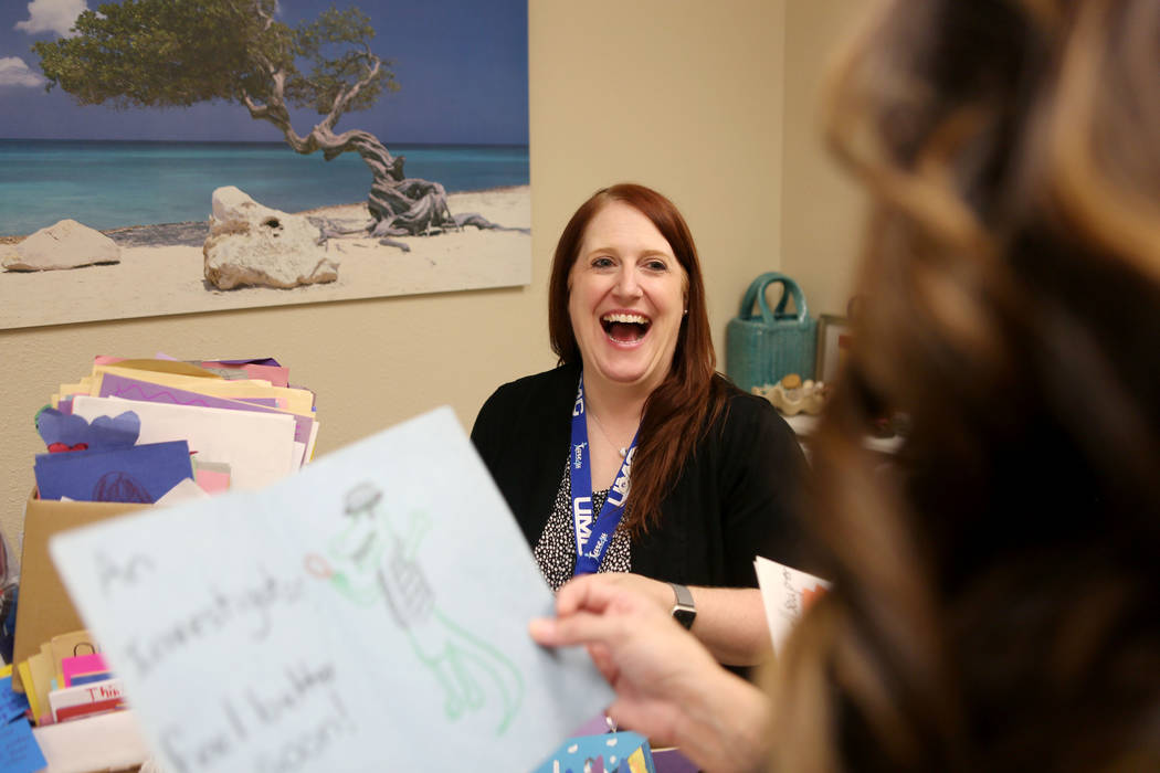 Tears mixed with laugher as the director of patient experience Haley Hammond listens to a witty card is read allowed while going through some of the countless cards given to patients and staff at  ...