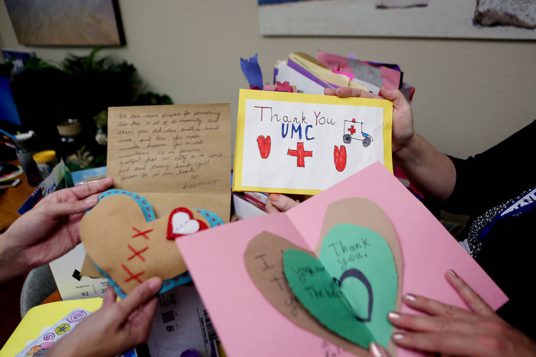 University Medical Center employees hold cards sent from around the country given to patients and staff at UMC after the  Oct. 1, tragedy, Thursday, Oct 26, 2017 at UMC in Las Vegas. Elizabeth Bru ...