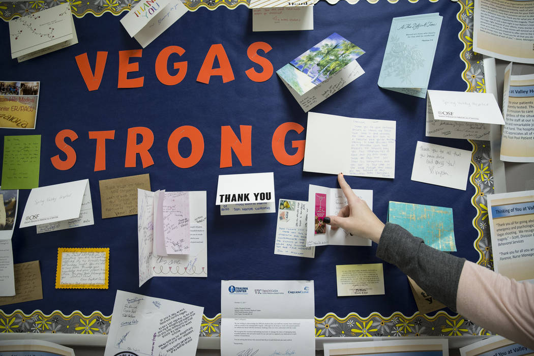 Carolyn Hafen, director of the emergency department at Spring Valley Hospital Medical Center, shows the cards of support and encouragement received at the hospital following the mass shooting, in  ...