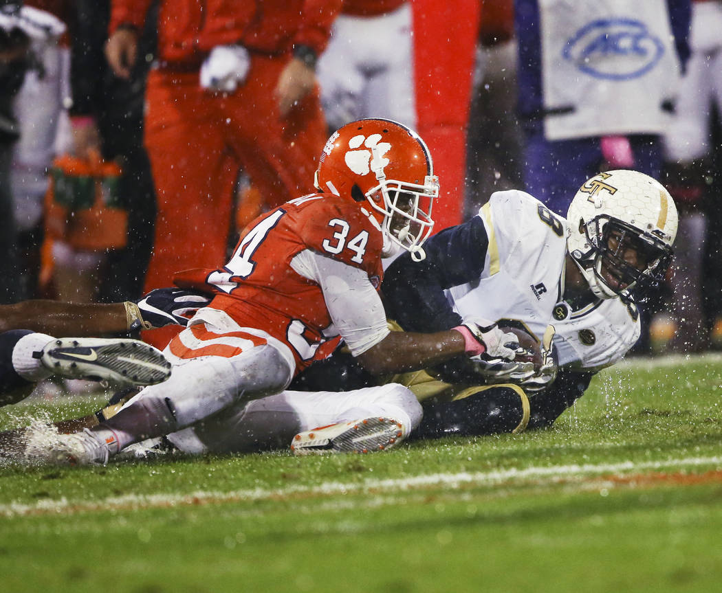 Georgia Tech defensive back Step Durham (8) battles Clemson wide receiver Ray-Ray McCloud (34) as he recovers a Clemson fumble in the first half of an NCAA college football game Saturday, Oct. 28, ...