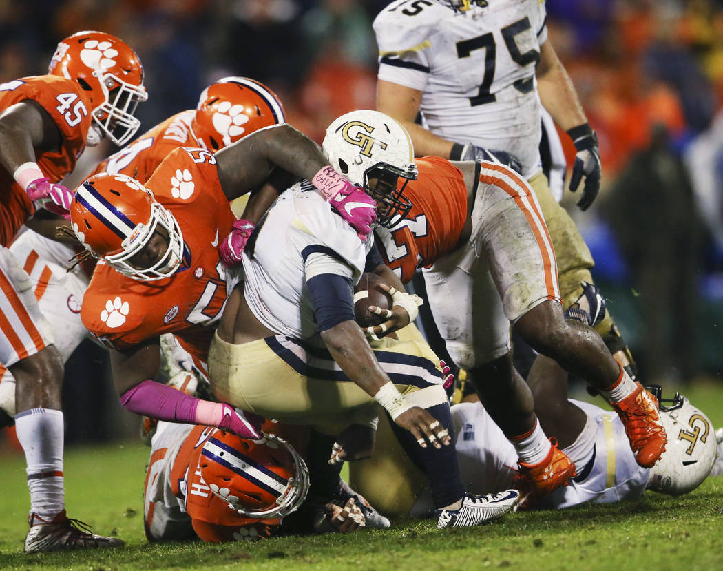 Georgia Tech running back KirVonte Benson (30) is stopped by the Clemson defense including Clemson defensive tackle Jabril Robinson (50) in the second half of an NCAA college football game Saturda ...