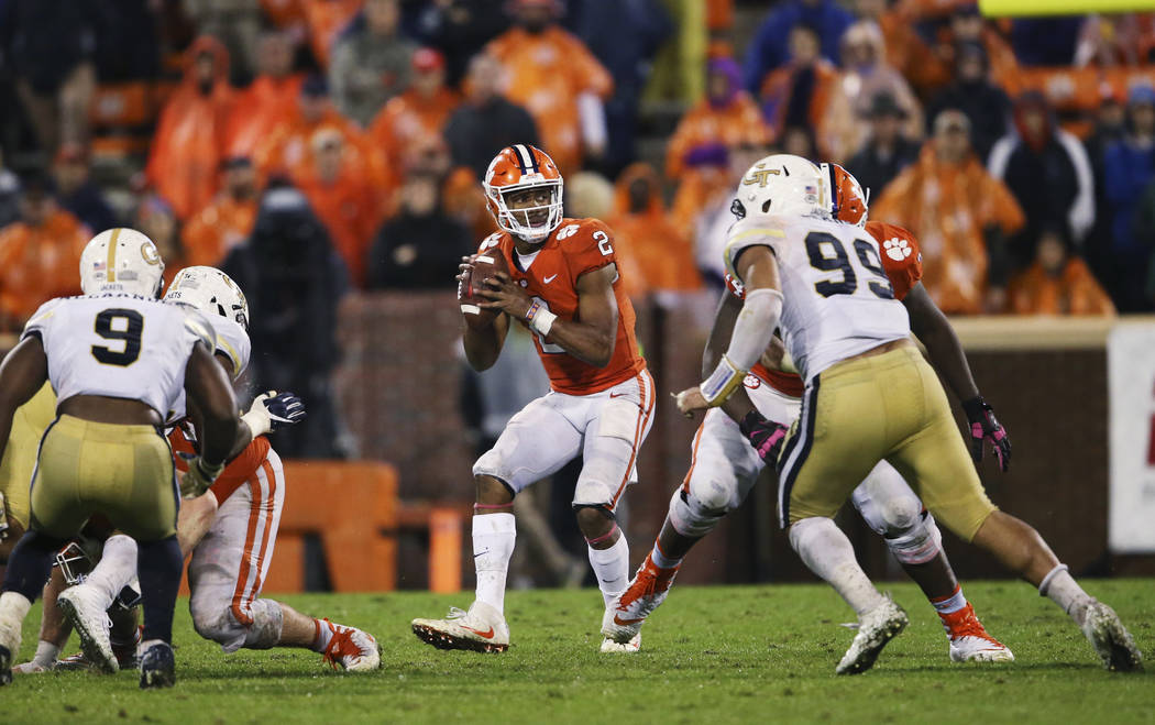 Clemson quarterback Kelly Bryant (2) looks to pass as Georgia Tech defensive lineman Desmond Branch (99) defends in the second half of an NCAA college football game Saturday, Oct. 28, 2017, in Cle ...