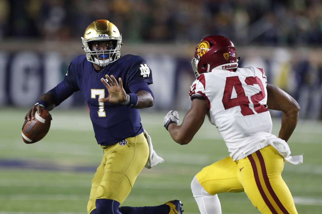Oct 21, 2017; South Bend, IN, USA; Notre Dame Fighting Irish quarterback Brandon Wimbush (7) scrambles out of the pocket against Southern California Trojans linebacker Uchenna Nwosu (42) at Notre  ...