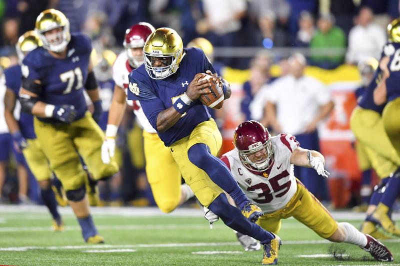 Oct 21, 2017; South Bend, IN, USA; Notre Dame Fighting Irish quarterback Brandon Wimbush (7) escapes pressure by USC Trojans linebacker Comeron Smith (35) in the fourth quarter at Notre Dame Stadi ...