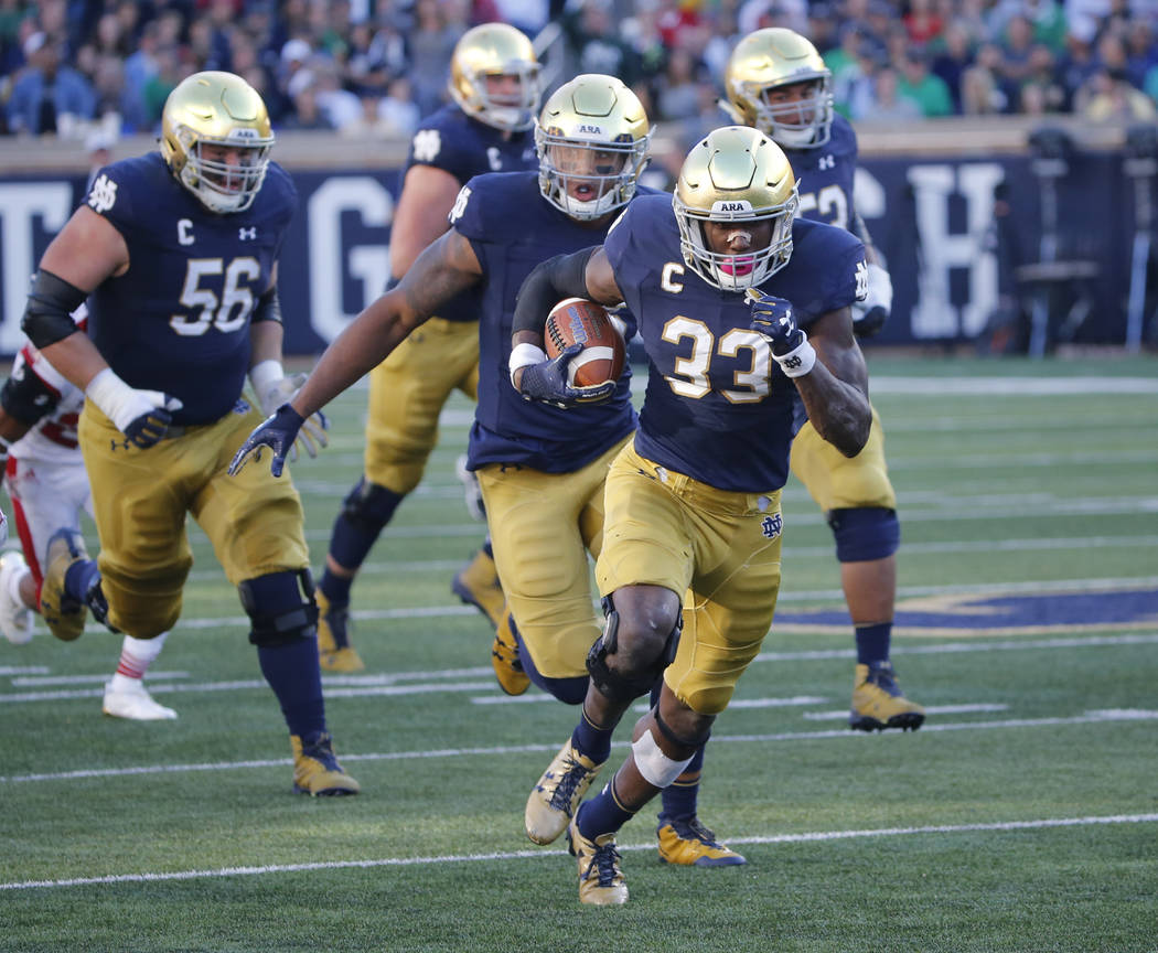 Notre Dame running back Josh Adams heads for the end zone on his touchdown run during the first half of an NCAA college football game against Miami (Ohio) Saturday, Sept. 30, 2017, in South Bend,  ...