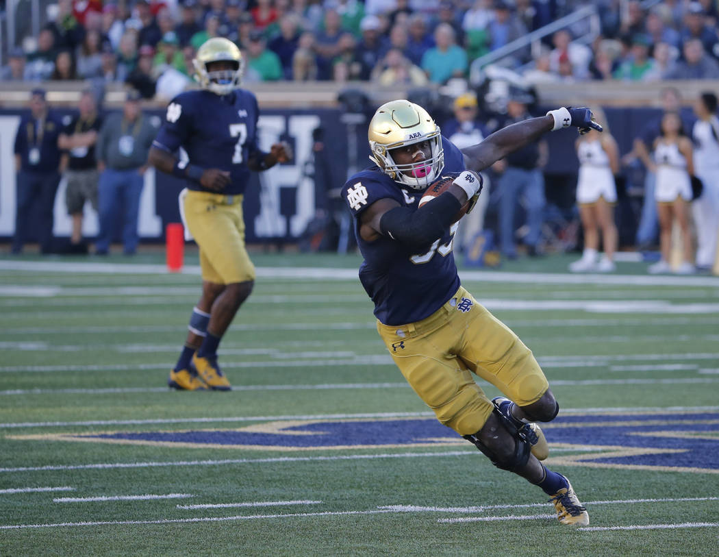 Notre Dame running back Josh Adams makes a cut on his touchdown run during the first half of an NCAA college football game against Miami (Ohio) Saturday, Sept. 30, 2017, in South Bend, Ind. (AP Ph ...