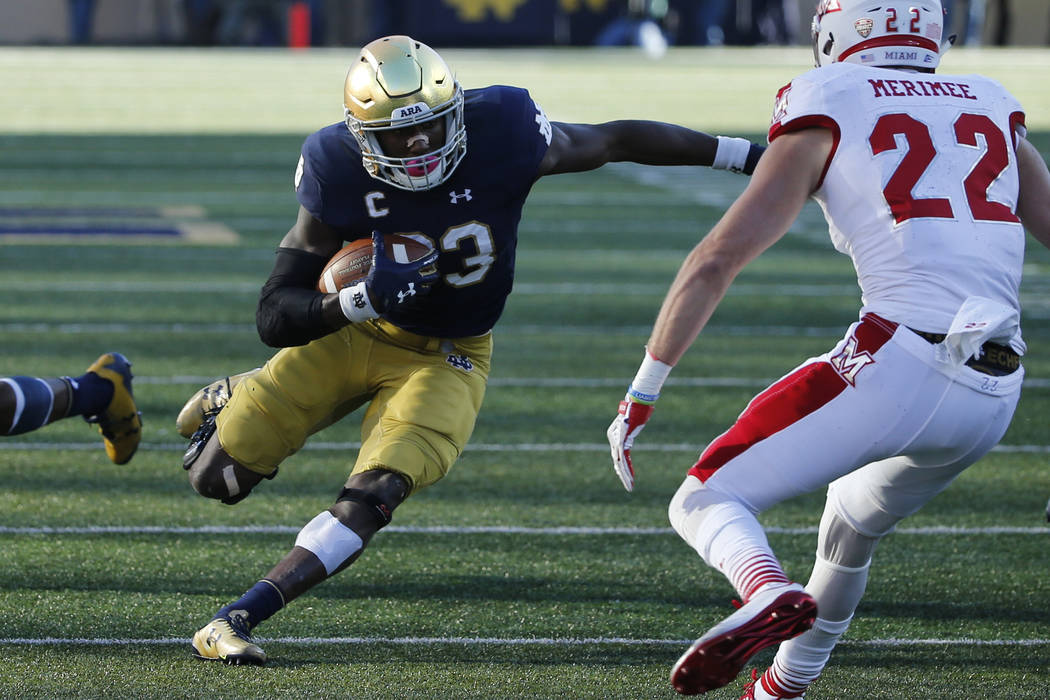 Notre Dame running back Josh Adams makes a cut on his run during the first half of an NCAA college football game against Miami (Ohio) Saturday, Sept. 30, 2017, in South Bend, Ind. (AP Photo/Charle ...