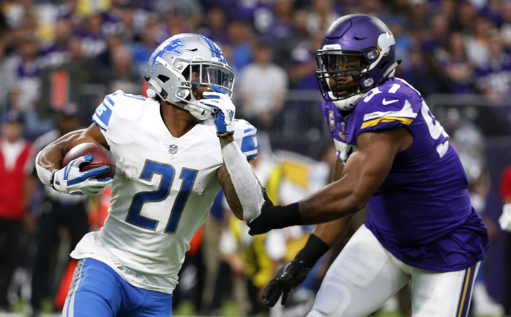 FILE - In a Sunday, Oct. 1, 2017 file photo, Detroit Lions running back Ameer Abdullah, left, runs from Minnesota Vikings defensive end Everson Griffen, right, during the first half of an NFL foot ...