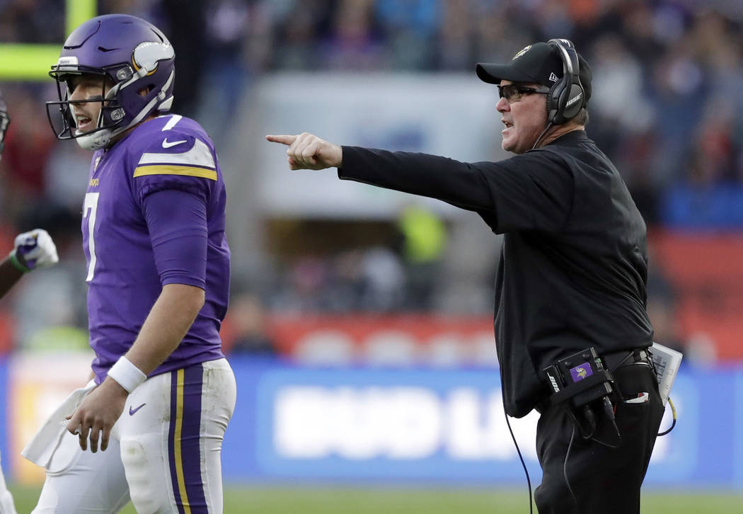 Minnesota Vikings head coach Mike Zimmer, right, shouts out as he gestures behind Minnesota Vikings quarterback Case Keenum (7) during the second half of an NFL football game against Cleveland Bro ...