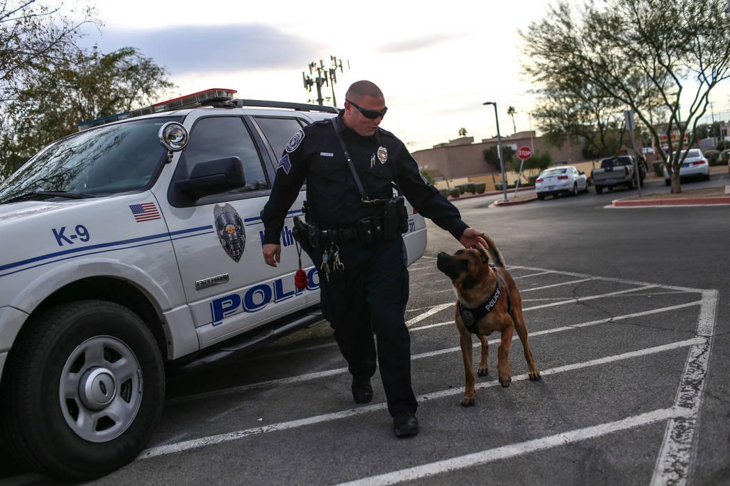 North Las Vegas Police Sgt. Scott Salkoff walks K-9 officer Storm outside city hall in North Las Vegas, Monday, Oct. 30, 2017. Joel Angel Juarez Las Vegas Review-Journal @jajuarezphoto