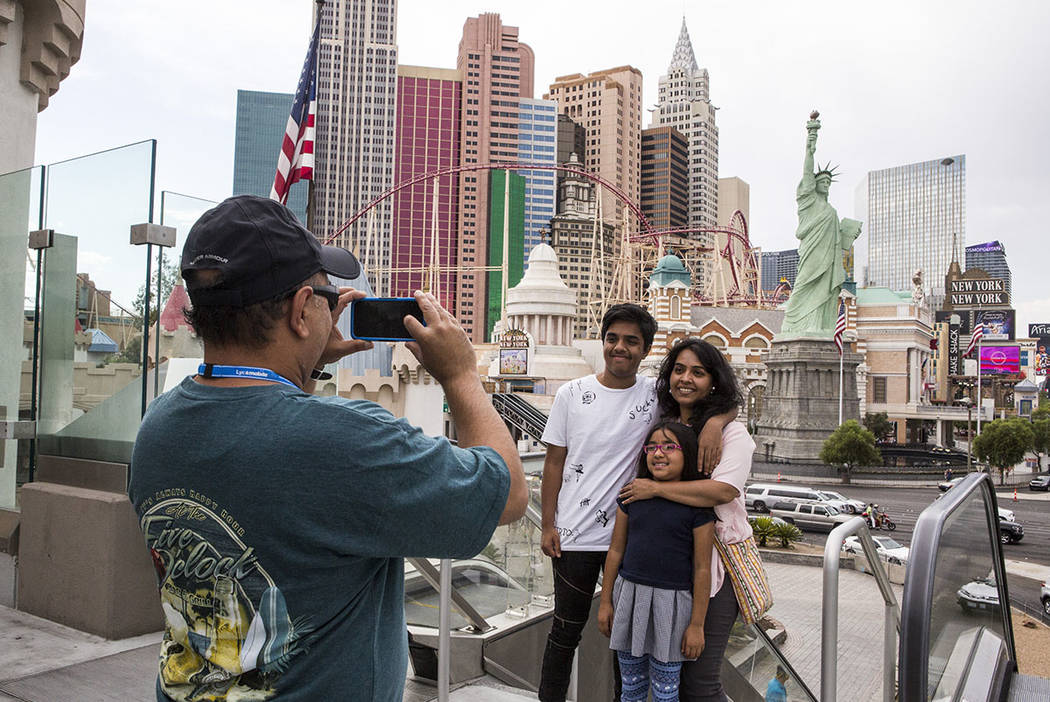 Ashish Mehta takes a photo of his wife Ami and children Arnav, 14, and Veda, 7, on the Las Vegas Strip on Monday, July 17, 2017. The family was visiting from Illinois.  (Las Vegas Review-Journal)
