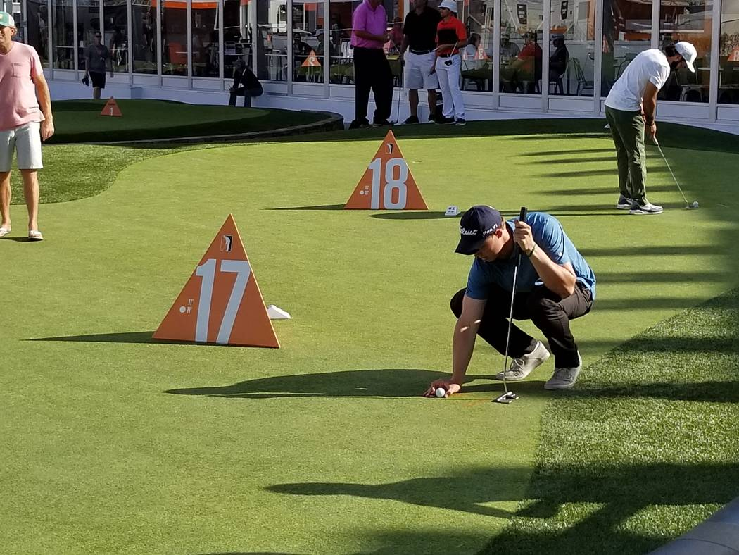 Jordan Wright lines up a putt on the 17th hole during the Major Series of Putting Team Championship on Thursday. (David Schoen/Las Vegas Review-Journal)