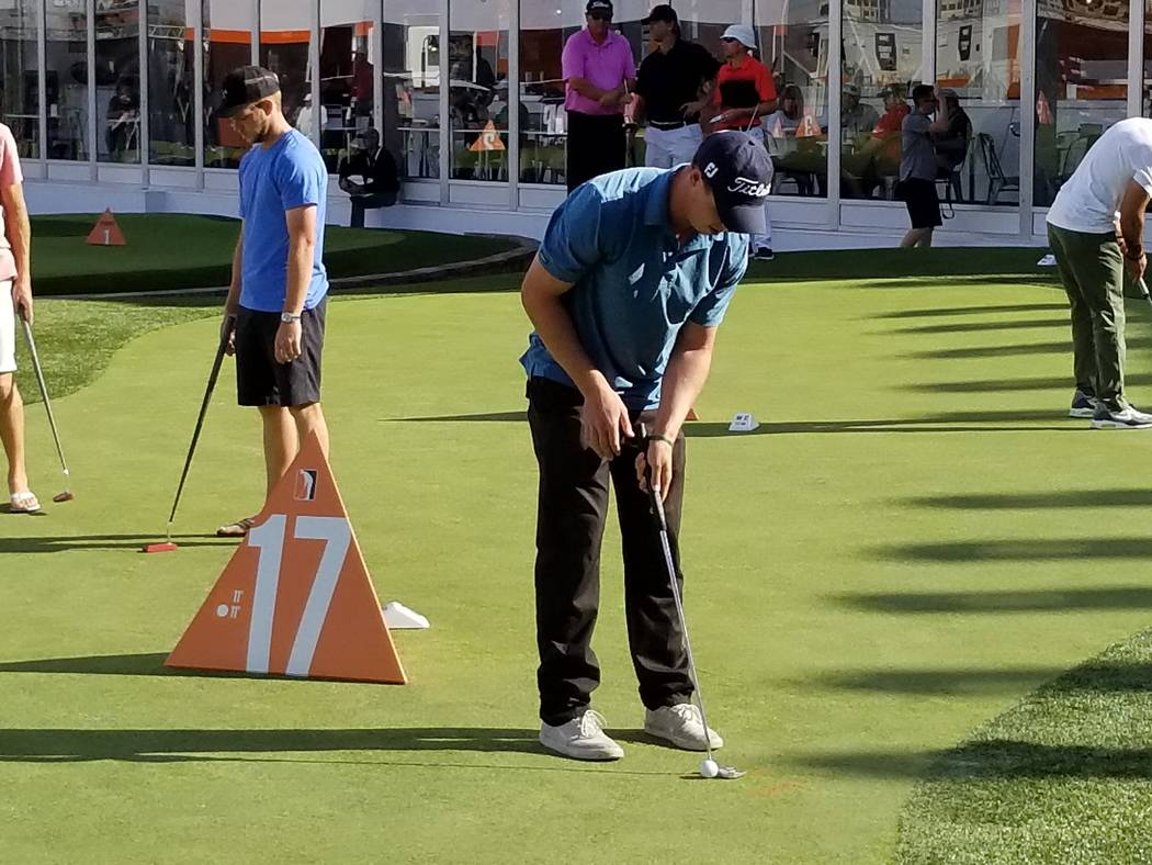 Jordan Wright prepares to hit a putt on the 17th hole during the Major Series of Putting Team Championship on Thursday. (David Schoen/Las Vegas Review-Journal)