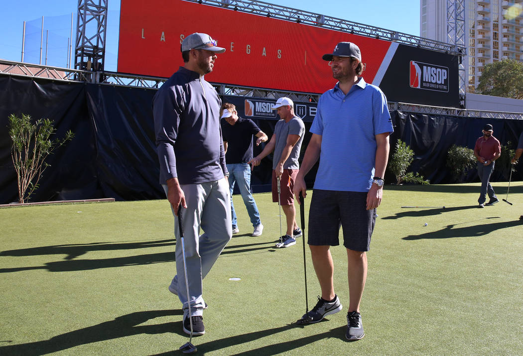 Former Major League Baseball pitcher Josh Beckett, left, and former professional tennis player, Mardy Fish, chat during their putting practice at Major Series of Putting Stadium on Saturday, Nov.  ...