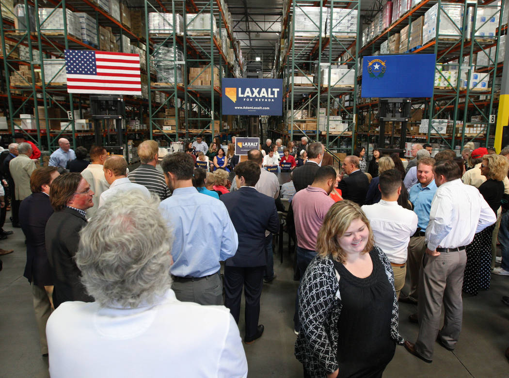 A crowd anxiously waits for Nevada Attorney General Adam Laxalt to announced his candidacy for governor at Brady Industries's warehouse in Las Vegas, Wednesday, Nov. 1, 2017. Gabriella Benavidez L ...