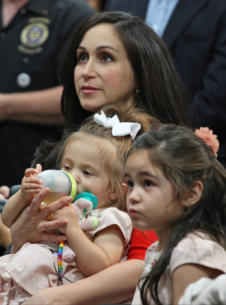 Jaime Laxalt, wife of Nevada Attorney General Adam Laxalt, sits with the couples children Isabella and Sophia at Brady Industries's warehouse in Las Vegas, during Laxalt's announcement that he is  ...
