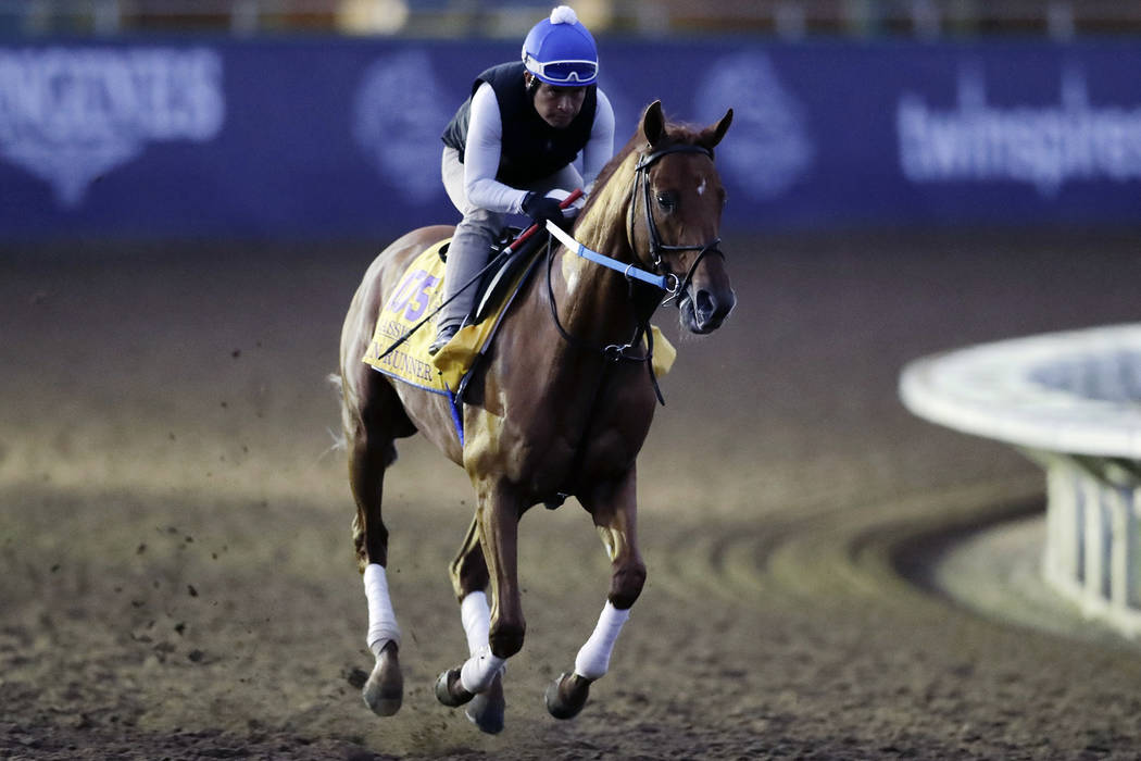 Exercise rider Angel Garcia rides Gun Runner during morning workouts before the Breeders Cup horse races Thursday, Nov. 2, 2017, in Del Mar, Calif. Del Mar is hosting the $28 million, 13-race Bree ...