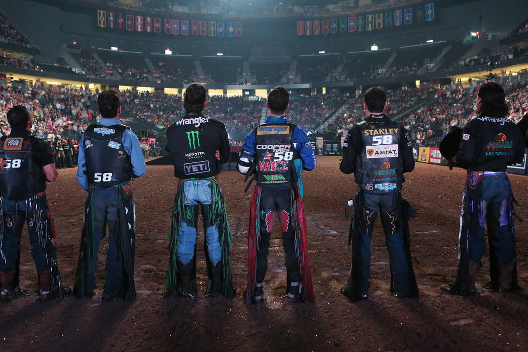 Riders are introduced during the Professional Bull Riders World Finals at T-Mobile Arena in Las Vegas on Wednesday, Nov. 1, 2017. All riders has the number 58 on the back of their vests for the 58 ...