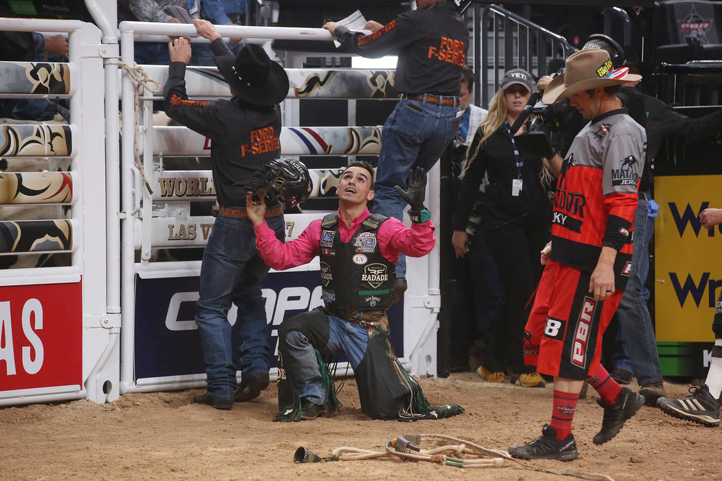 Jose Vitor Leme kneels in reaction to his successful ride during the Professional Bull Riders World Finals at T-Mobile Arena in Las Vegas on Wednesday, Nov. 1, 2017. Bridget Bennett Las Vegas Revi ...