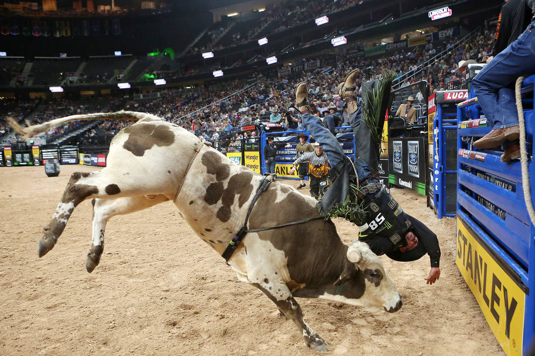 Chase Outlaw from Hamburg, Arkansas is bucked off during the Professional Bull Riders World Finals at T-Mobile Arena in Las Vegas on Wednesday, Nov. 1, 2017. Bridget Bennett Las Vegas Review-Journ ...