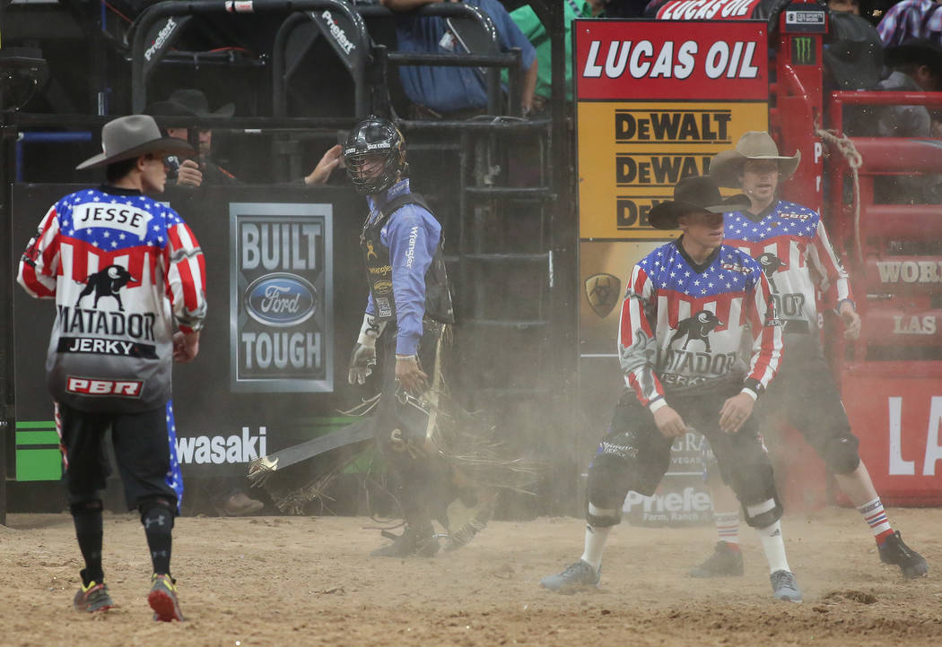 Sage Kimzey, second from left, walks out of the arena after being bucked off Souixper Stinger during the Professional Bull Riders World Finals at T-Mobile Arena in Las Vegas on Thursday, Nov. 2, 2 ...