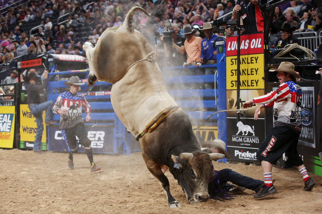 Emilio Resende is bucked off SweetPro's Bruiser during the Professional Bull Riders World Finals at T-Mobile Arena in Las Vegas on Thursday, Nov. 2, 2017. Bridget Bennett Las Vegas Review-Journal  ...