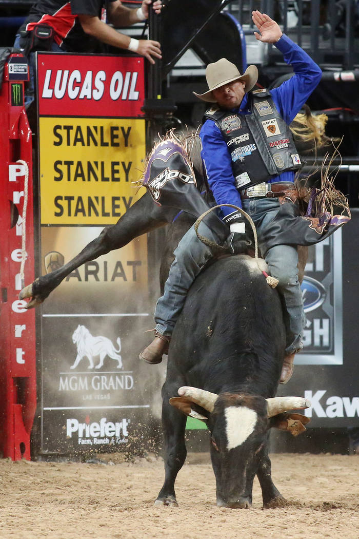 Eduardo Aparecido from Gouvelandia, Brazil rides Freak Of Nature during the Professional Bull Riders World Finals at T-Mobile Arena in Las Vegas on Thursday, Nov. 2, 2017. Bridget Bennett Las Vega ...
