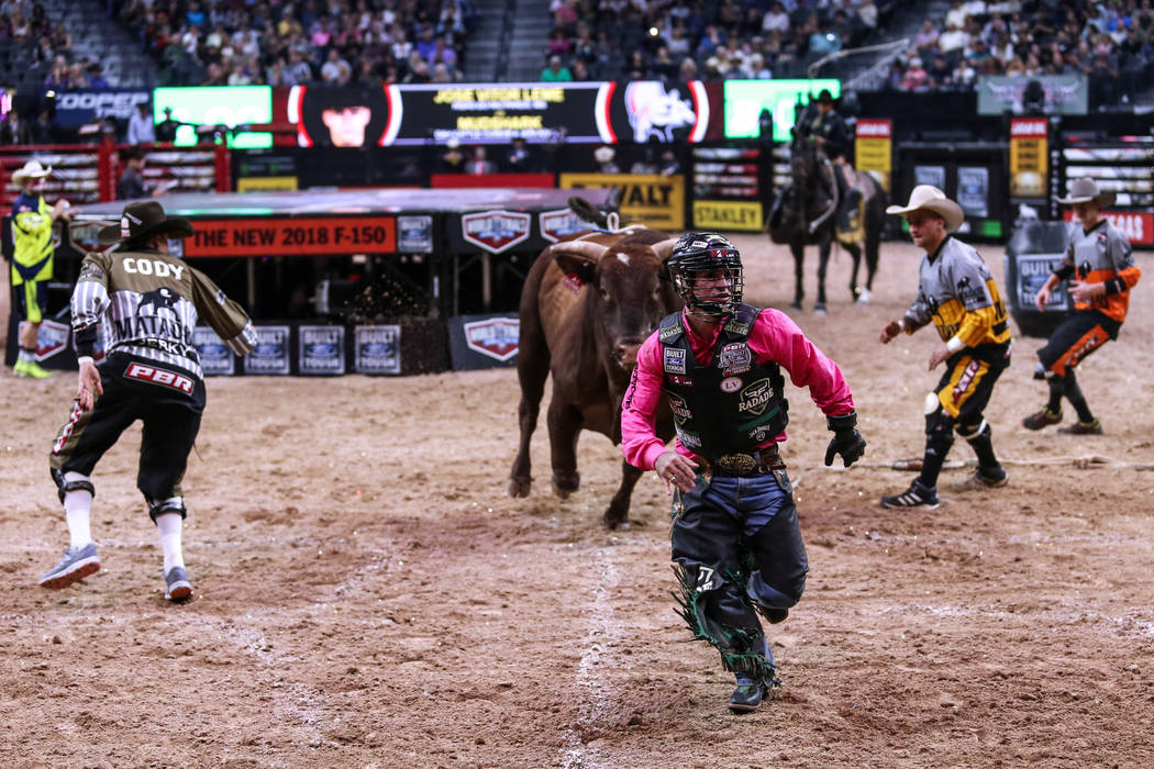 Jose Vitor Leme runs away from a bull during the Professional Bull Riders World Finals at T-Mobile Arena in Las Vegas, Friday, Nov. 3, 2017. Joel Angel Juarez Las Vegas Review-Journal @jajuarezphoto