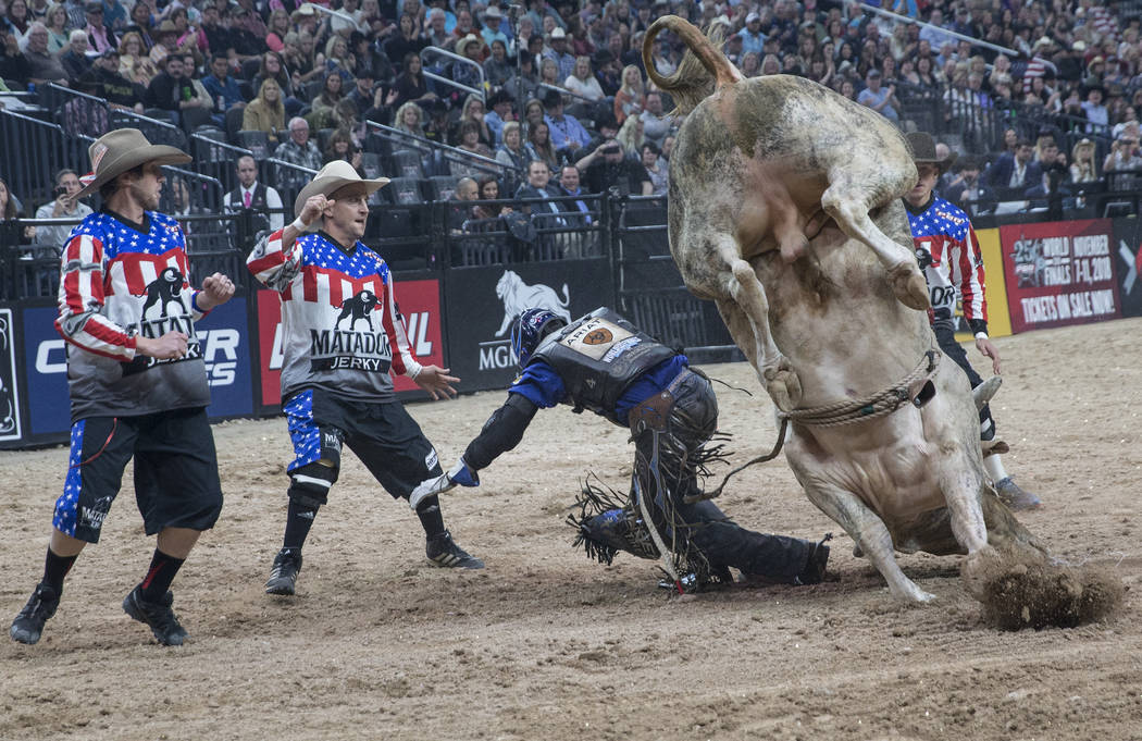 Ryan Dirteater rides Pick-It Construction's Find Jesus during the Professional Bull Riders World Finals on Saturday, Nov. 4, 2017, at T-Mobile Arena, in Las Vegas. Benjamin Hager Las Vegas Review- ...