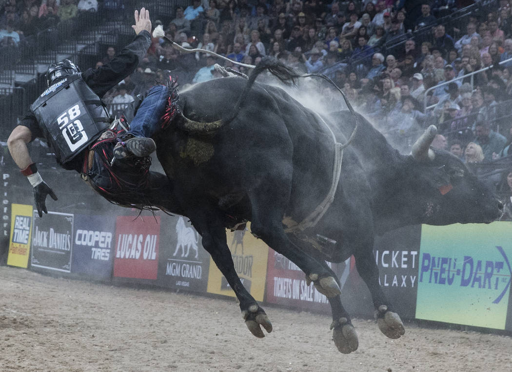 Ramon de Lima gets bucked off of Big Black Cat during the Professional Bull Riders World Finals on Saturday, Nov. 4, 2017, at T-Mobile Arena, in Las Vegas. Benjamin Hager Las Vegas Review-Journal  ...