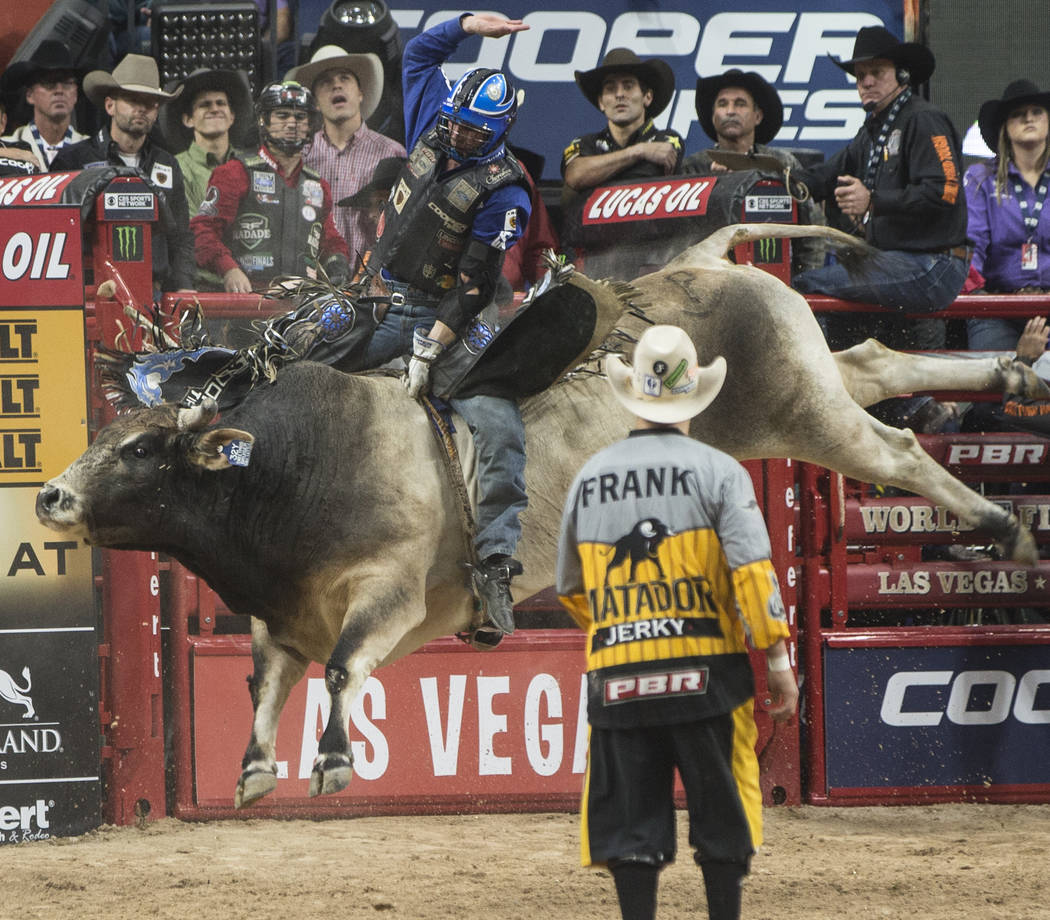 Ryan Dirteater rides SweetPro's Bruiser during the Professional Bull Riders World Finals on Sunday, Nov. 5, 2017, at T-Mobile Arena, in Las Vegas. SweetPro's Bruiser was the 2017 PBR world champio ...