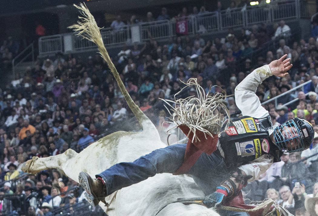 Mike Lee rides Milky Jones during the Professional Bull Riders World Finals on Sunday, Nov. 5, 2017, at T-Mobile Arena, in Las Vegas. Benjamin Hager Las Vegas Review-Journal @benjaminhphoto