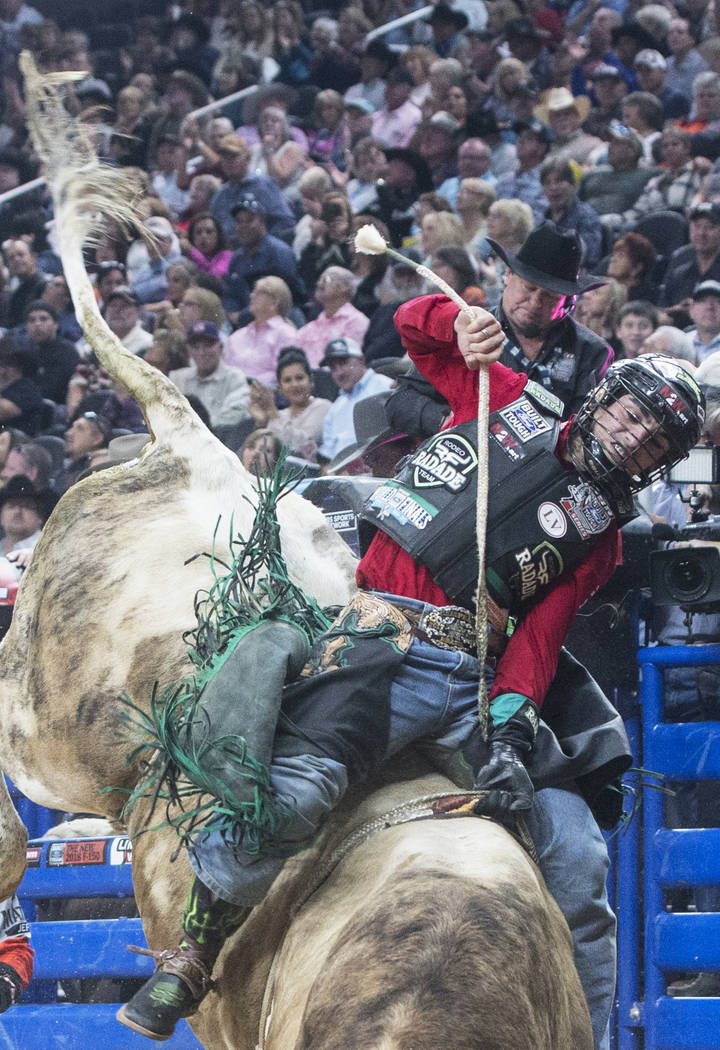 Jose Vitor Leme rides More Big Bucks during the Professional Bull Riders World Finals on Sunday, Nov. 5, 2017, at T-Mobile Arena, in Las Vegas. Leme was the 2017 PBR World Finals Event Winner and  ...