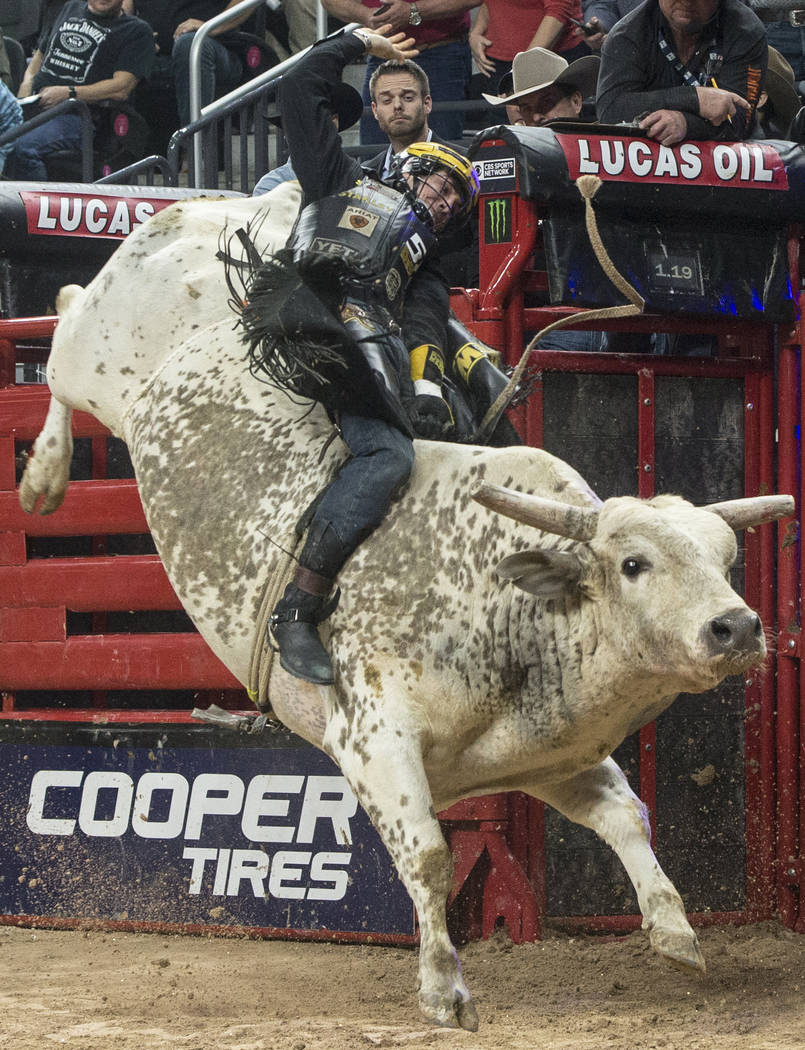 Jess Lockwood rides Lester Gillis during the Professional Bull Riders World Finals on Sunday, Nov. 5, 2017, at T-Mobile Arena, in Las Vegas. Lockwood went on to win the 2017 Professional Bull Ride ...