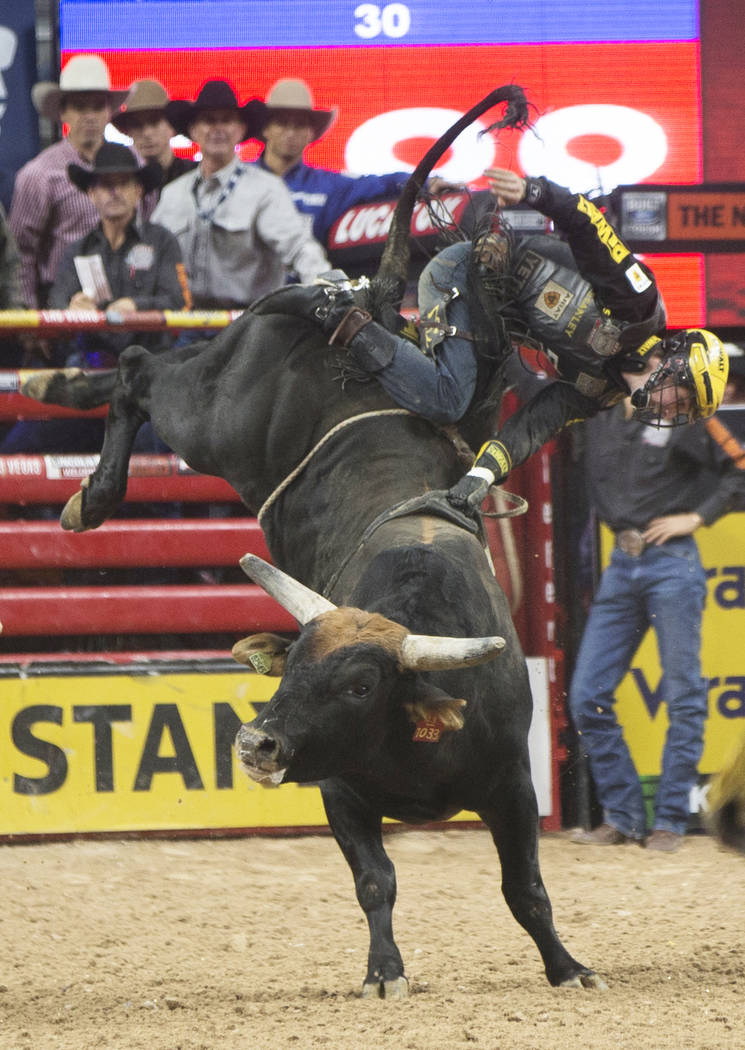 Jess Lockwood gets thrown from Mystikal during the Professional Bull Riders World Finals on Sunday, Nov. 5, 2017, at T-Mobile Arena, in Las Vegas. Lockwood went on to win the 2017 Professional Bul ...