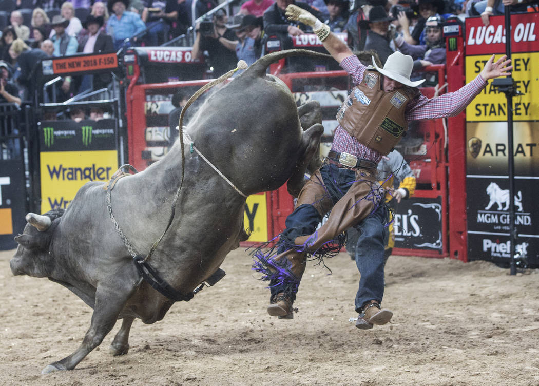 Emilio Resende gets thrown off Cut The Cord during the Professional Bull Riders World Finals on Sunday, Nov. 5, 2017, at T-Mobile Arena, in Las Vegas. Benjamin Hager Las Vegas Review-Journal @benj ...