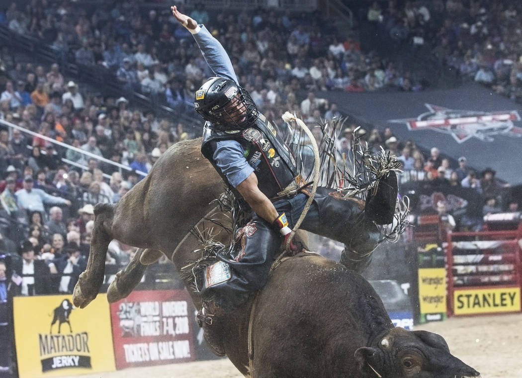 Rubens Barbosa rides Cooper Tires Brown Sugar during the Professional Bull Riders World Finals on Sunday, Nov. 5, 2017, at T-Mobile Arena, in Las Vegas. Benjamin Hager Las Vegas Review-Journal @be ...