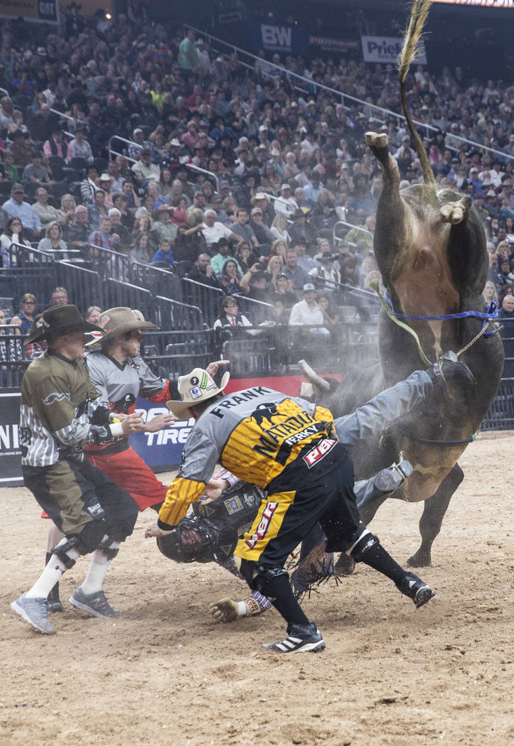 Bullfighters try to help Lachlan Richardson get unhooked from Freak of Nature during the Professional Bull Riders World Finals on Sunday, Nov. 5, 2017, at T-Mobile Arena, in Las Vegas. Benjamin Ha ...