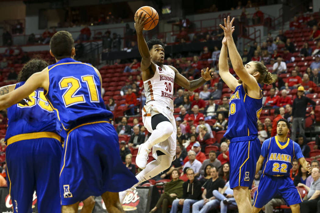 UNLV Rebels guard Jovan Mooring (30) goes up for a point against the Alaska Nanooks during an exhibition basketball game at the Thomas & Mack, Friday, Nov. 3, 2017. UNLV defeated the Nanooks 9 ...