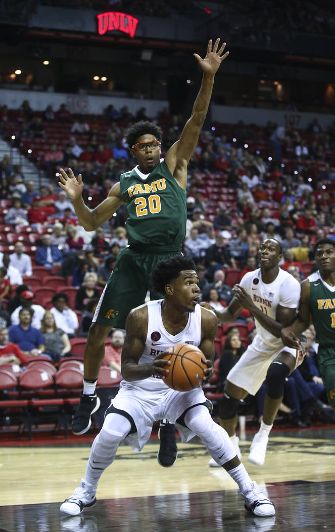 Florida A&M's Brendon Myles (20) defends as UNLV's Jovan Mooring (30) looks to shoot during their basketball game at the Thomas & Mack Center in Las Vegas on Saturday, Nov. 11, 2017. Chase ...