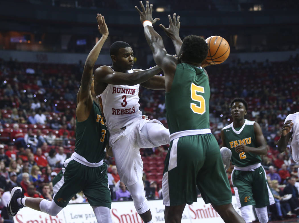 UNLV's Amauri Hardy (3) passes the ball past Florida A&M's Nasir Core (5) during their basketball game at the Thomas & Mack Center in Las Vegas on Saturday, Nov. 11, 2017. Chase Stevens La ...