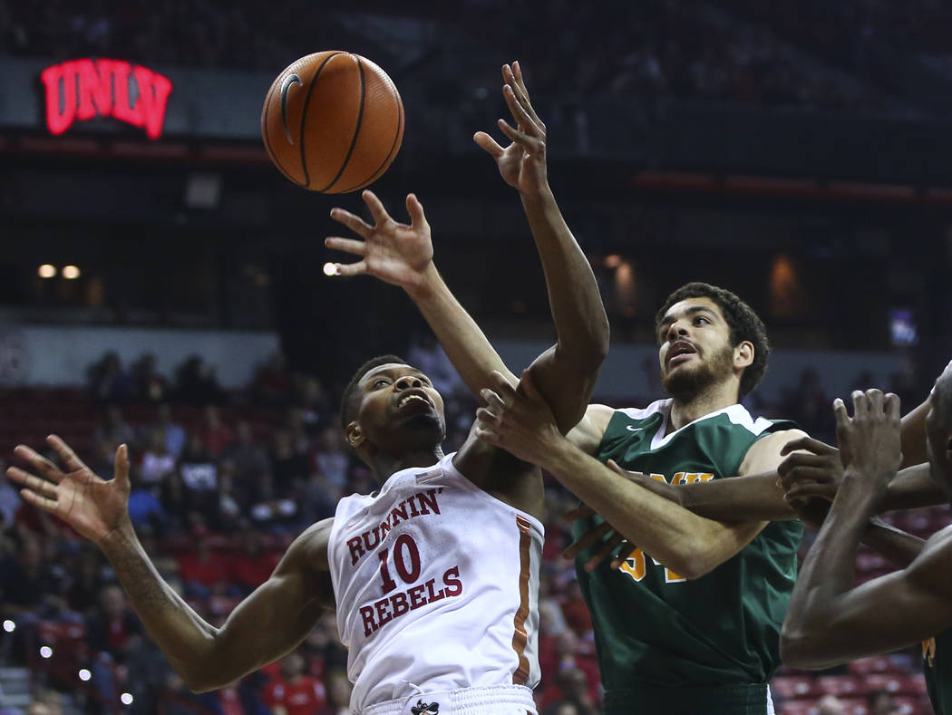 UNLV's Shakur Juiston (10) and Florida A&M's center Isaiah Martin (34) fight for the ball during their basketball game at the Thomas & Mack Center in Las Vegas on Saturday, Nov. 11, 2017.  ...