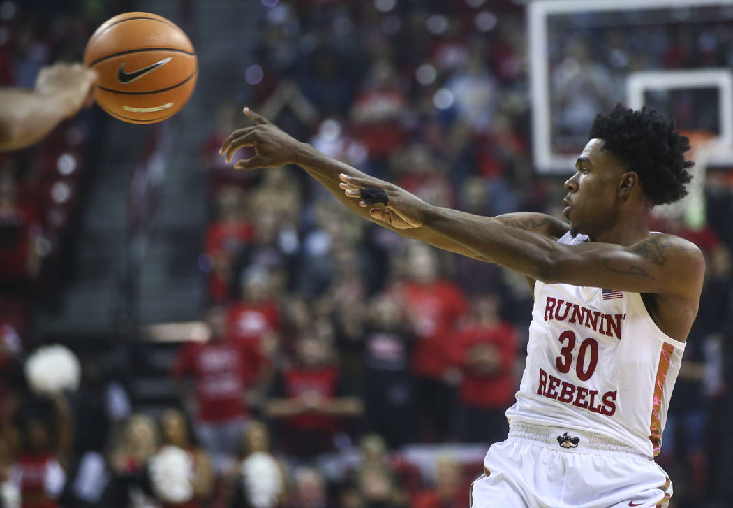 UNLV's Jovan Mooring (30) passes the ball during their basketball game against Florida A&M at the Thomas & Mack Center in Las Vegas on Saturday, Nov. 11, 2017. Chase Stevens Las Vegas Revi ...