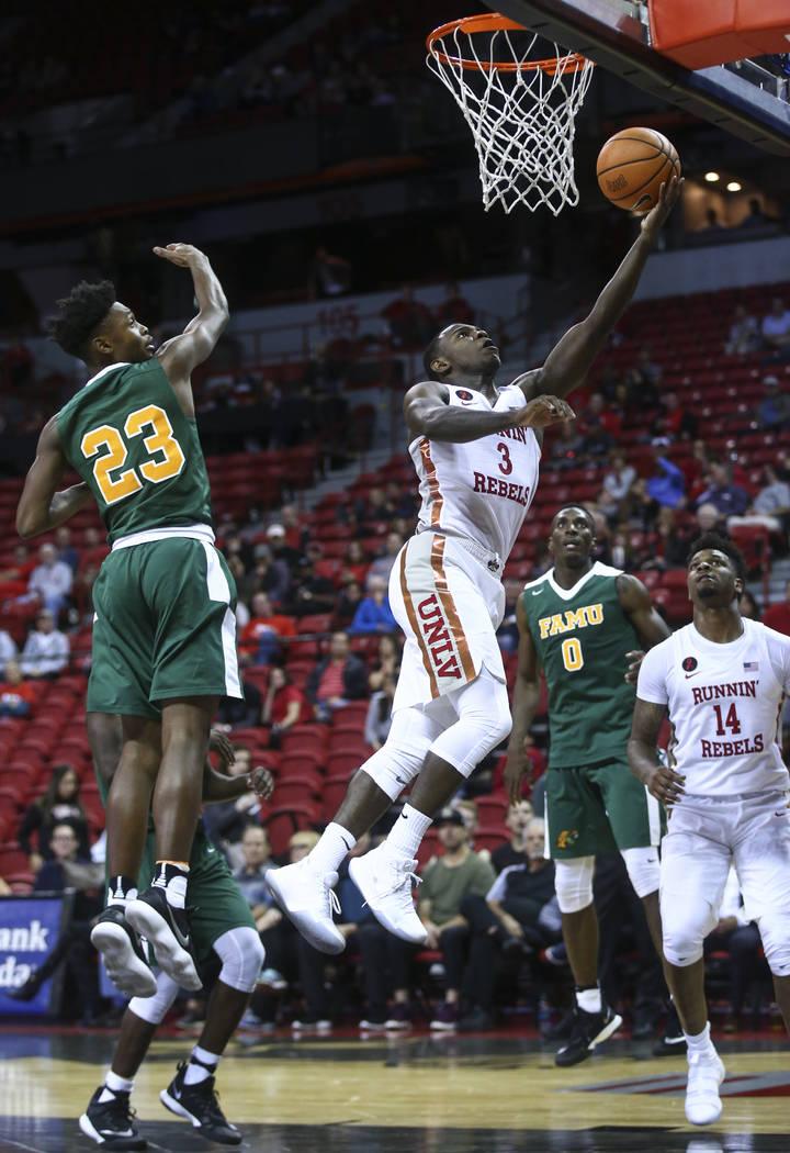 UNLV's Amauri Hardy (3) goes to the basket against Florida A&M during their basketball game at the Thomas & Mack Center in Las Vegas on Saturday, Nov. 11, 2017. Chase Stevens Las Vegas Rev ...