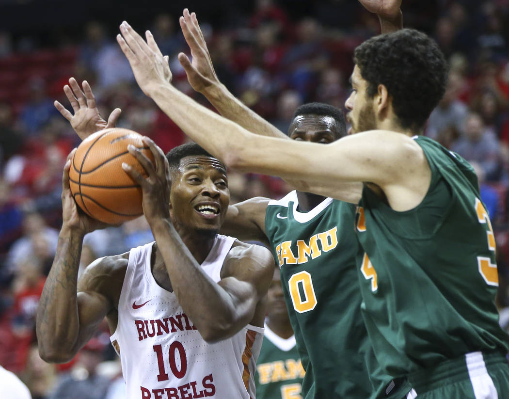 Florida A&M's Desmond Williams (0) and Isaiah Martin (34) guard UNLV's Shakur Juiston (10) during their basketball game at the Thomas & Mack Center in Las Vegas on Saturday, Nov. 11, 2017. ...